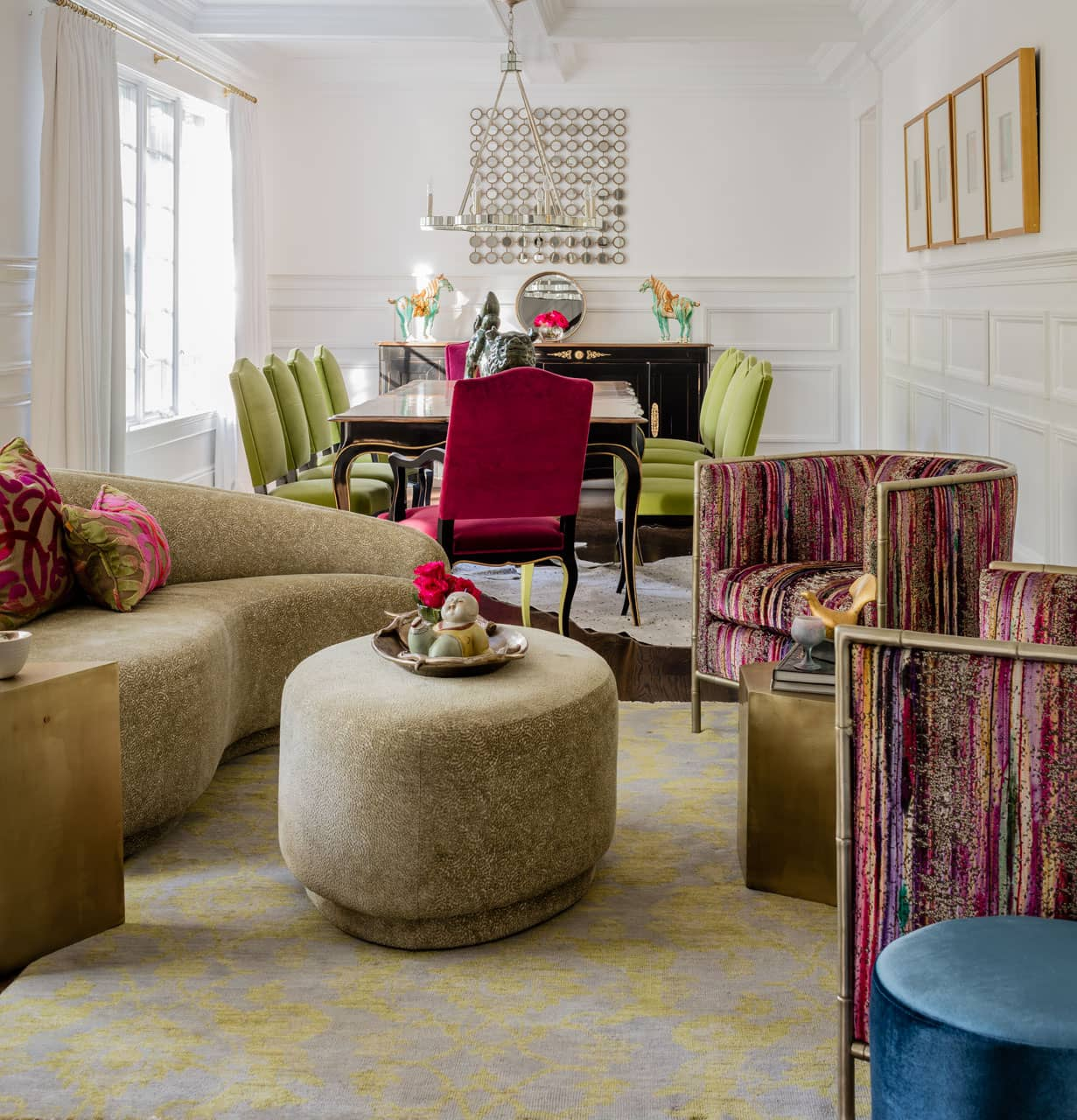 Colorfully upholstered tub chairs were the inspiration for magenta and lime green touches found throughout the elongated space.